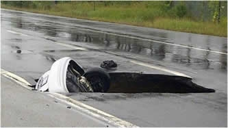 Collapsed steel sewer causes sinkhole in Canadian highway.  Concrete pipe provides fix.